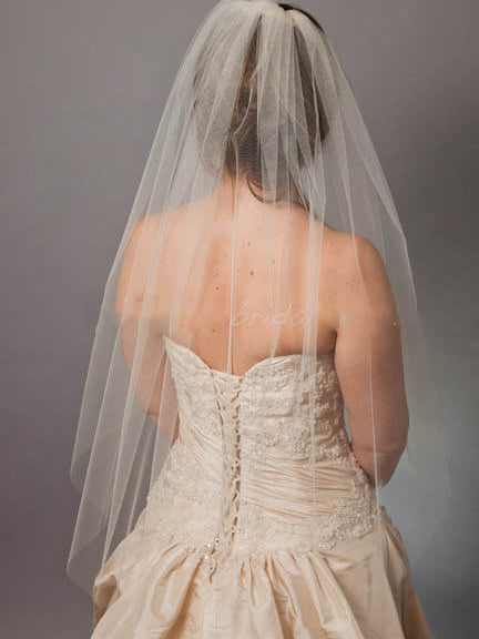 One-tier elbow length tulle bridal veil with raw cut edge