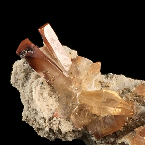 Topaz with rutile inclusions; Tepetate, Mexico - Alexandria Mineral Shop
