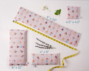 4 ice packs/boo boo bags laid out to show the different sizes. Fabric is pink ballerina.