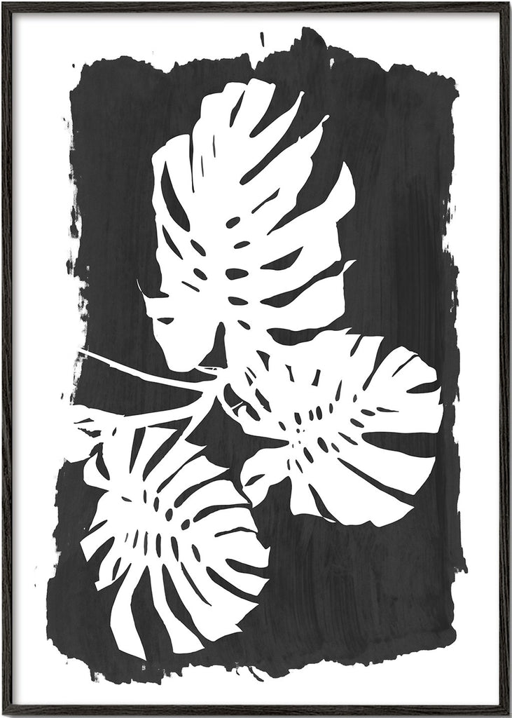 Monstera leaves on black paint