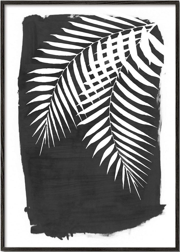 Palm leaves on black paint
