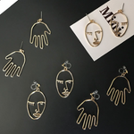 Golden Faces & Hands Dangly Statement Earrings