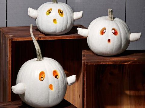 pumpkins decorated with paint and food to look like ghosts