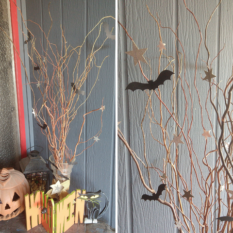 paper bats glued to twigs for Halloween decoration