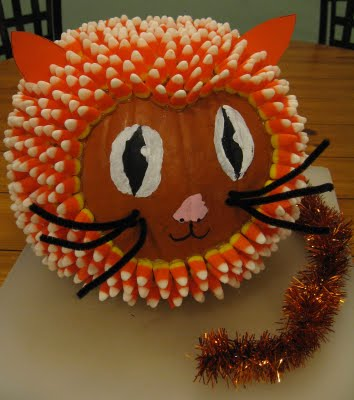 pumpkin decorated as a cat with candy corn