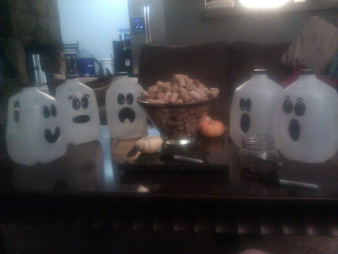 milk jugs decorated to look like ghosts
