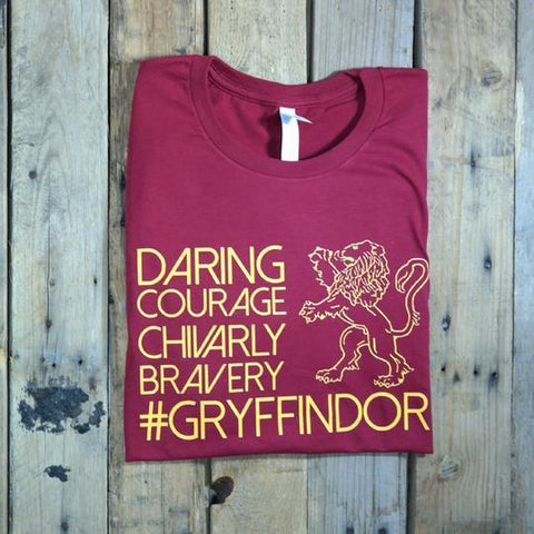 cardinal shirt with orange words daring courage chivarly bavery gryffindor