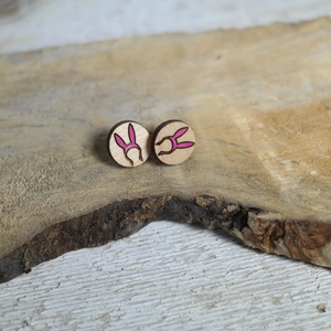 maple wood round earrings with laser cut image of bunny ears hat pained pink