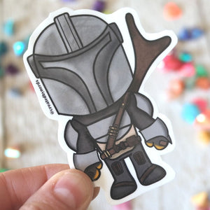 sticker of chibi drawing of the mandalorian