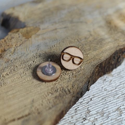 maple wood round earrings with glasses engraved in center