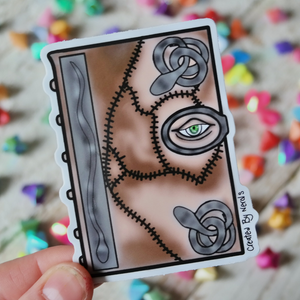 Vinyl Sticker of Creepy spell book with eye