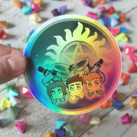 Vinyl Holographic sticker with chibi drawing of demon staying trio