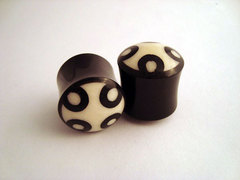 Horn Plugs With Bone Dust Circles