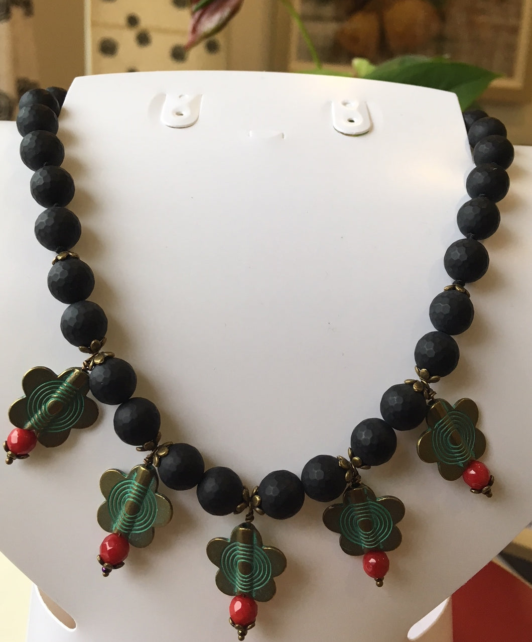Black agate and brass charms necklace.