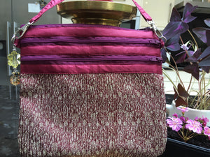 Maroon and gold silk shoulder bag