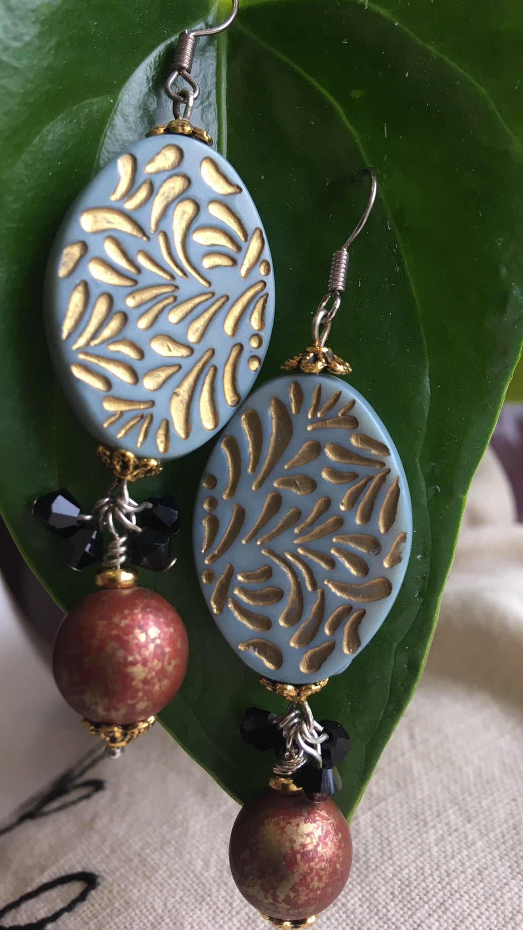 Sea blue and gold earrings