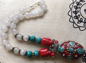 Faceted glass beads and large Tibetan pendant necklace
