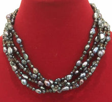 Multistrand black pearls necklace