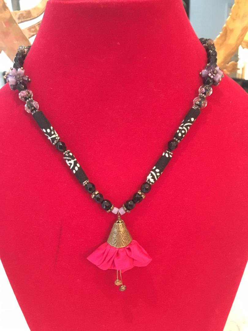 Fabric beads necklace with a focal silk lily pendant