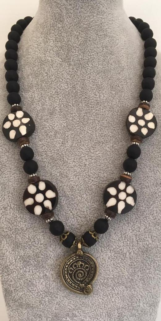 Black onyx and wood disc necklace.