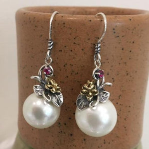 Floral sterling silver earrimngs with glass pearl