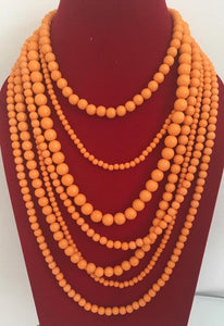 Multistrand necklace in orange