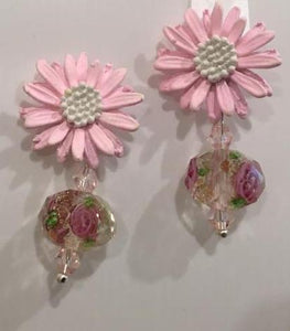 Pink floral earrings.