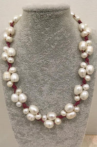 Pearls knotted on leather