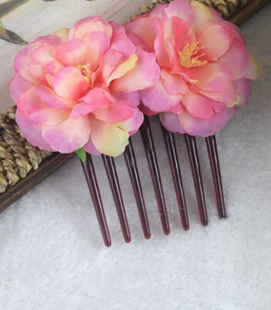 Side combs peachy roses