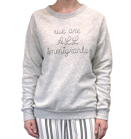 We are all immigrants eco-fleece Crewneck Sweatshirt with black Embroidery