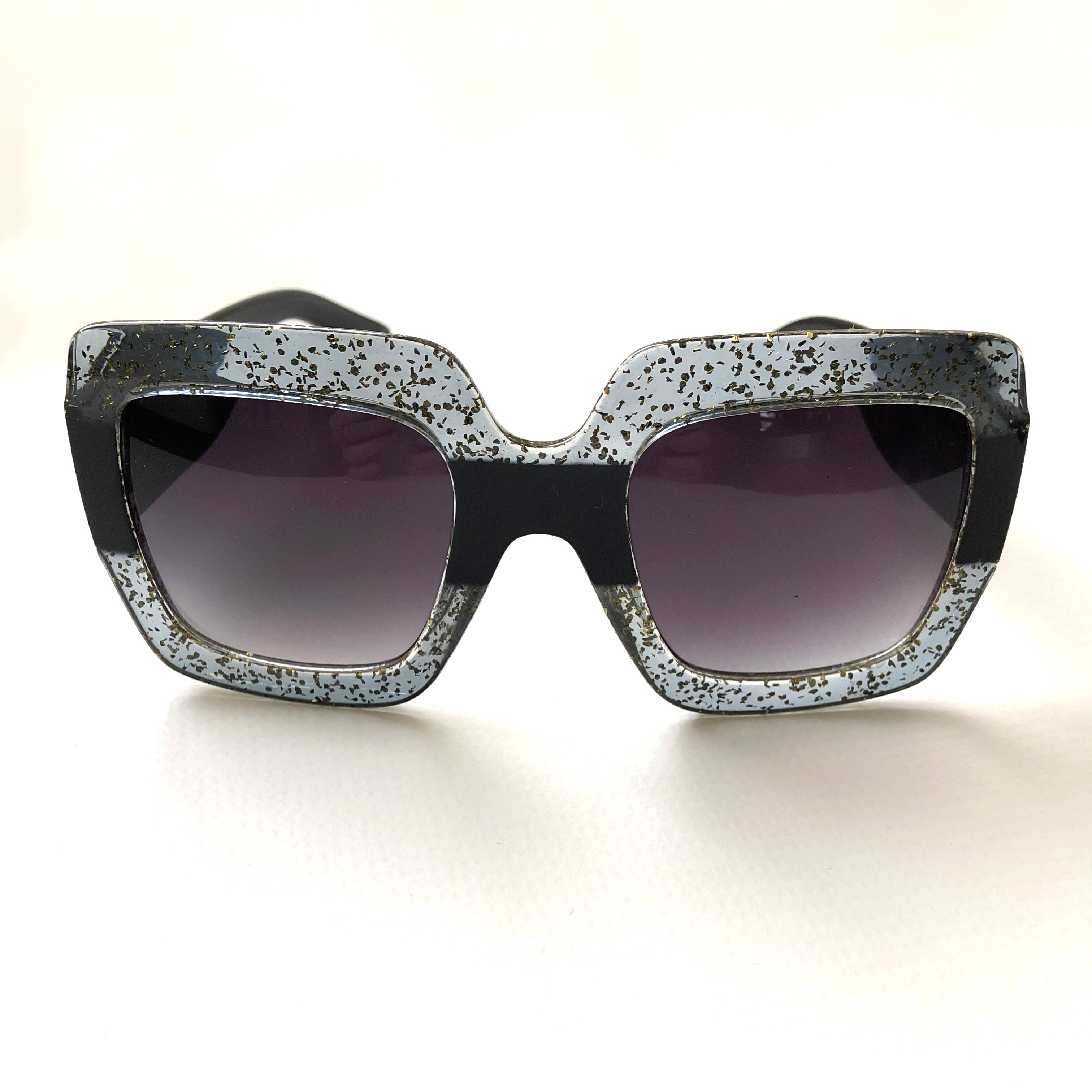 Clear and glitter and black sunglasses