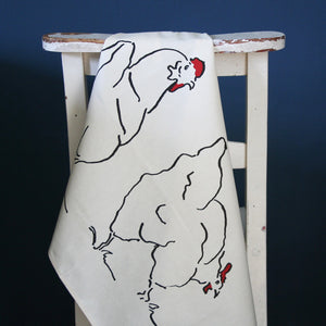 chicken tea towel from cluck cluck over a chair