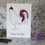 Load image into Gallery viewer, Happy Birthday rooster card hand finished with purple feathers from Cluck Cluck!