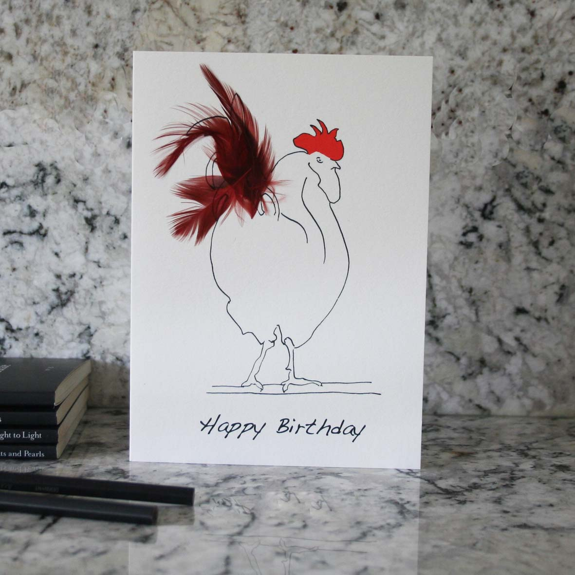 Herk Cockerel happy birthday card with red feathers