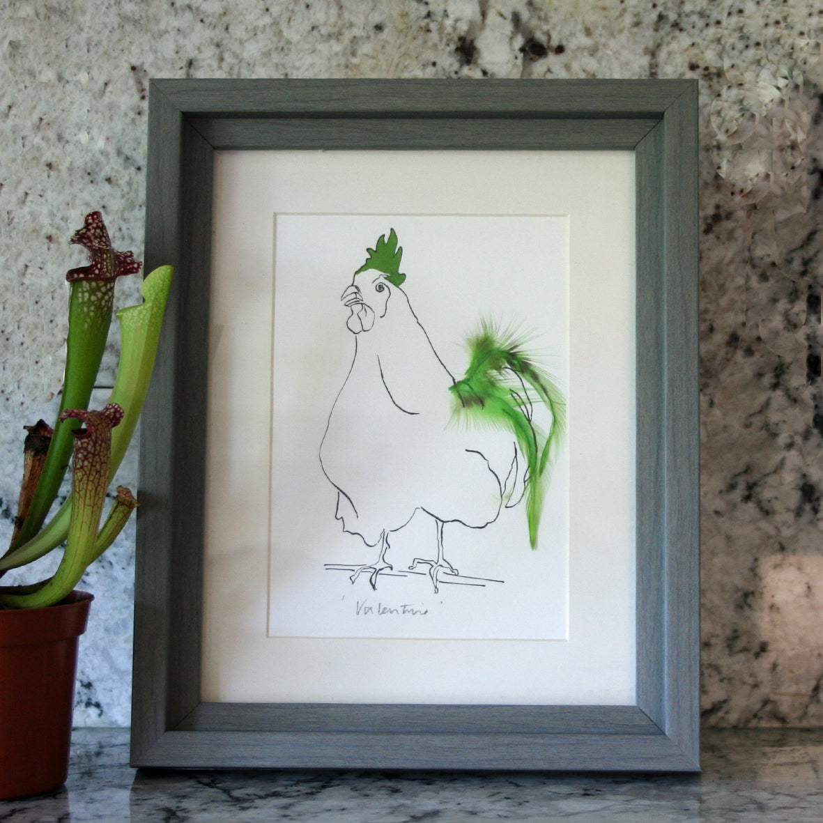 mini print with green feathers