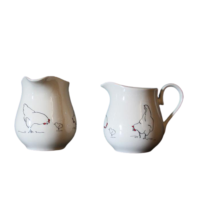 creamwear jugs with drawings of chickens, hens and chicks going round them
