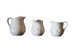 Load image into Gallery viewer, creamwear jug in three sizes with drawings of chickens, hens and chicks going round them