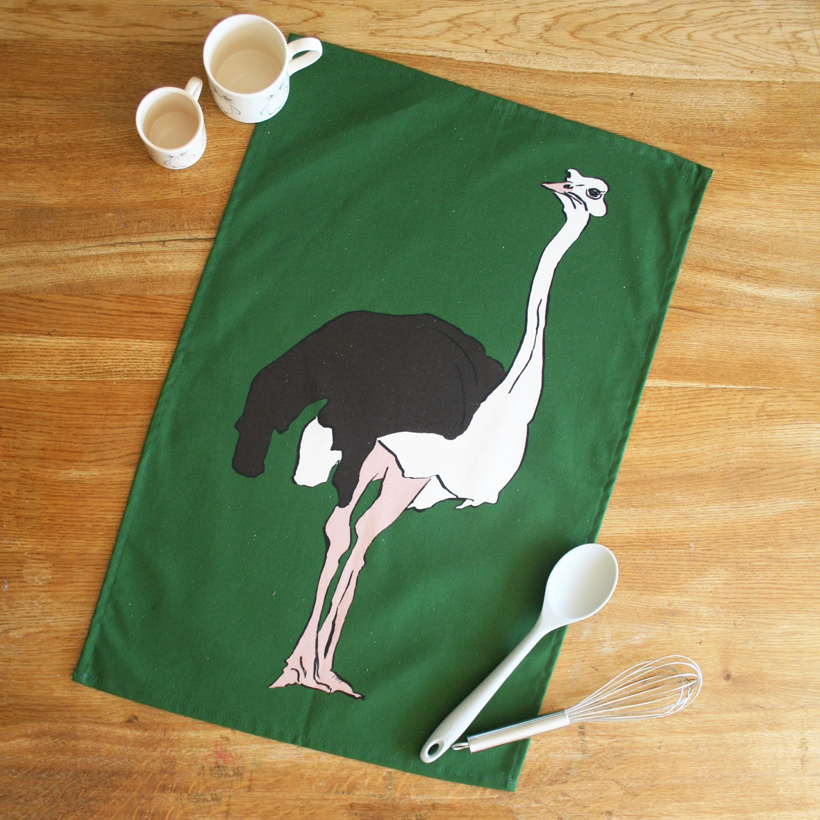 green tea towel with ostrich design