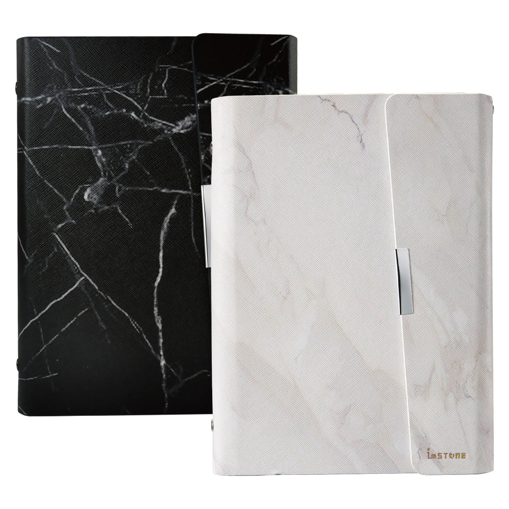 Anti-Theft Stone Binder; black marble cover at the left, white marble cover at the right.