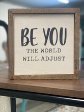 Be you the world will adjust box sign