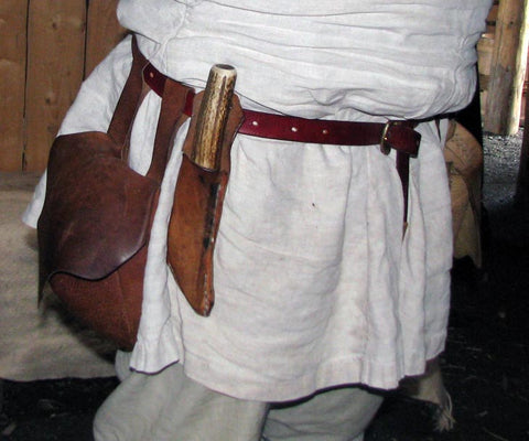 viking belt reenactment in leather with bronze buckle and knife and bag attached