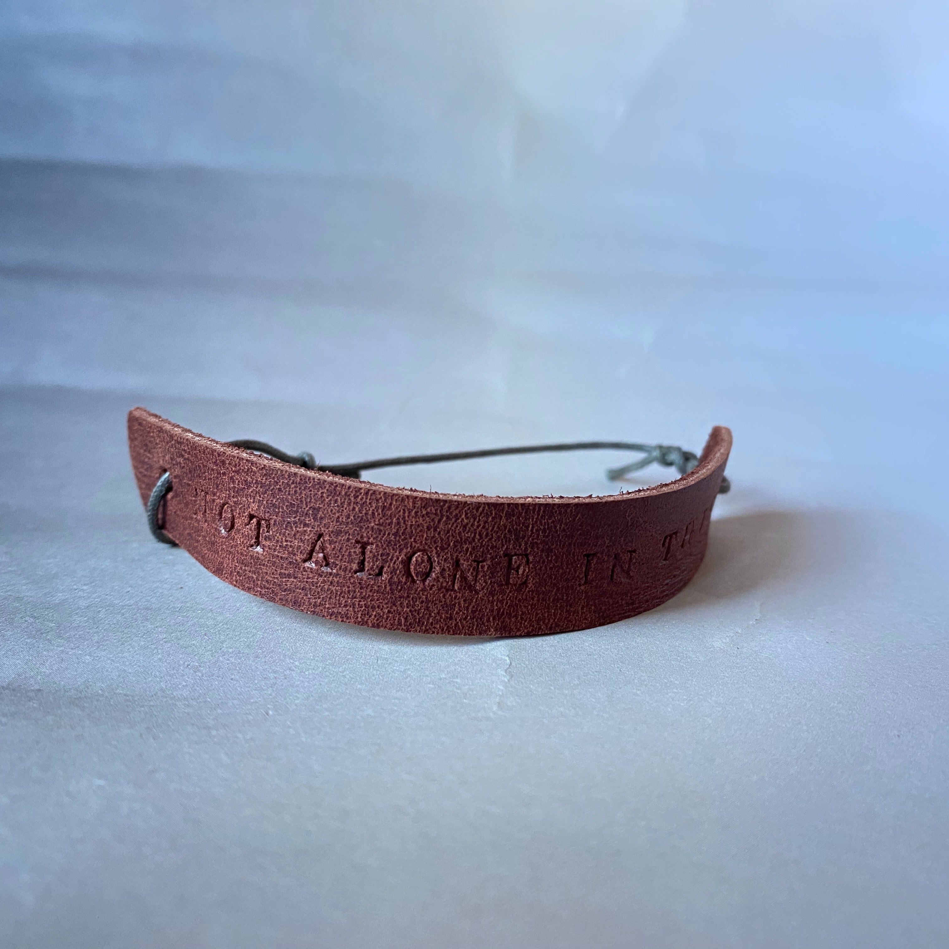 "Leather Quote Bracelet ""Not Alone In This"""