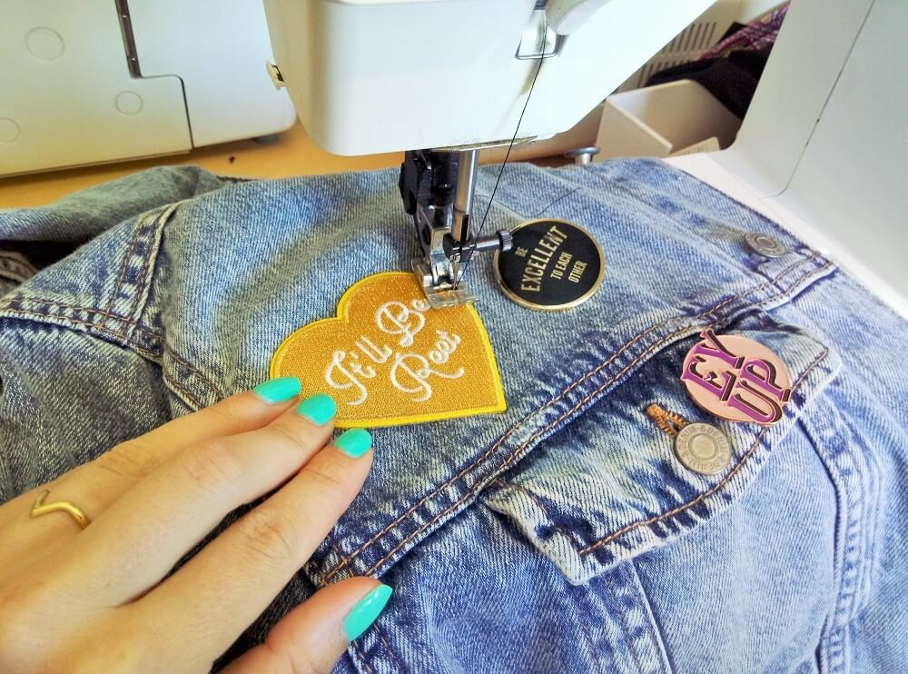 Sewing a patch on to a denim jacket