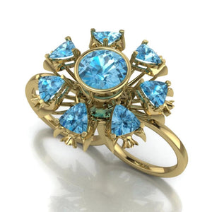 Fish Double Ring by Lisa Lesunja, Yellow Gold 750 18K with 7 Trillion Cut Swiss Blue Topaz 4.88ct. and 1 Brilliant cut Swiss Blue Topaz 3.52ct. (7576)