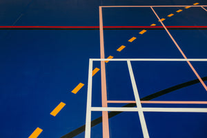 Blue indoor sports hall with red, yellow, and white abstract lines