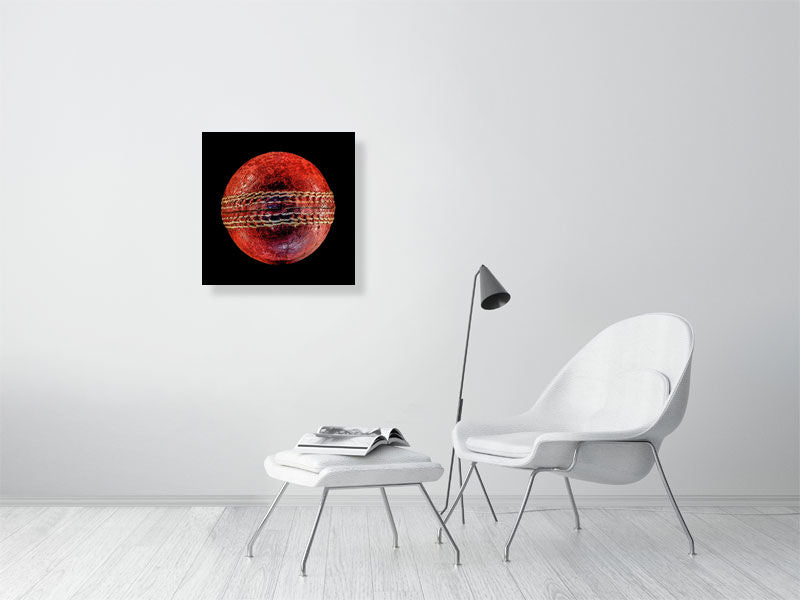 Cricket ball on black background print on living room wall