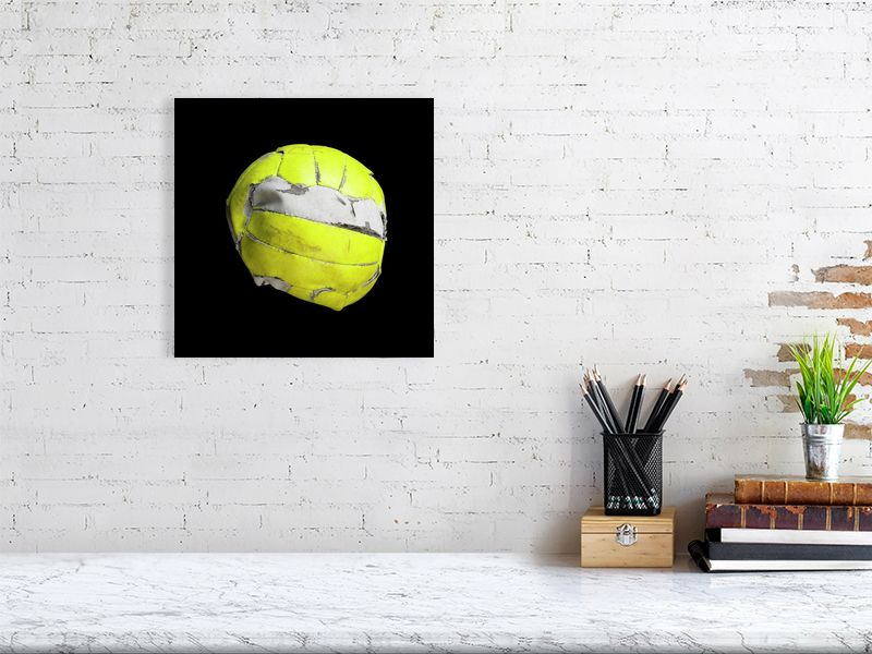 Yellow floorball on black background print above desk