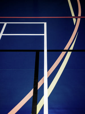 Blue sports hall print with white, pink, and black lines