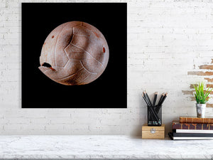 Open image in slideshow, Brown volleyball on black background print above desk