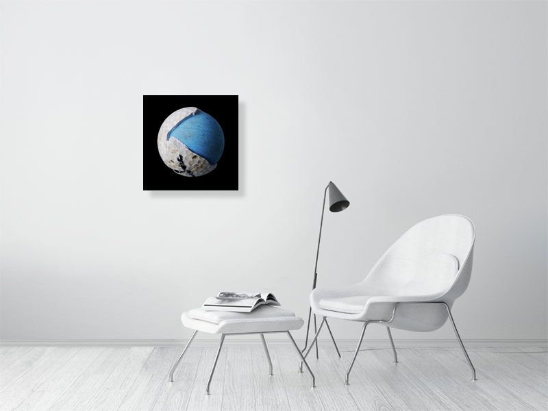 Blue and white golf ball on black background print on living room wall